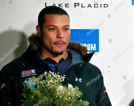 United States' Ryan Bailey smiles on the podium after finishing second in the two-man World Cup bobsled race in Lake Placid, N.Y. Bailey was banned for two years for what he contends was an inadvertent doping violation, ending the former track and field medalist's bid to compete in the Pyeongchang Olympics. The Court of Arbitration for Sport issued the ruling Friday, Dec. 1, 2017, agreeing with the U.S. Anti-Doping Agency's stance that a six-month ban Bailey served earlier this year was not enough