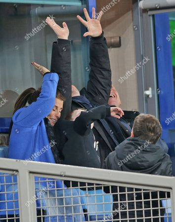 Stock Picture of Coleen Rooney with sons Kai Rooney and Klay Rooney watch the match from a private box and avoid flying balls from the pitch