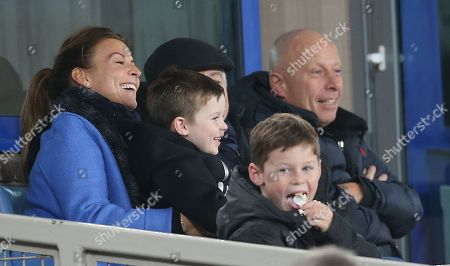 Coleen Rooney with sons Kai Rooney and Klay Rooney watch the match from a private box
