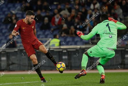 Roma's Kevin Strootman beats Spal goalkeeper Alfred Gomis to score his side's second goal during an Italian Serie A soccer match between AS Roma and Spal, at the Olympic stadium in Rome, Friday, Dec. 1st, 2017
