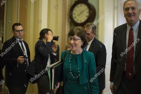 United States Senator Jeff Flake (Republican of Arizona) left, and US Senator Luther Strange (Republican of Alabama) right, led by US Senator Susan Collins (Republican of Maine) walk to the US Senate Chamber for a procedural vote in the US Capitol