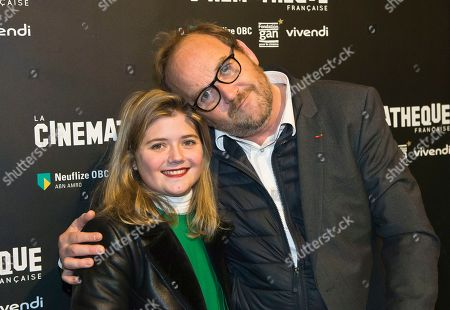 """French actress Gilbert Bonneau, left, and French director Xavier Beauvois pose during a photocall prior to the screening of the movie """"Les Gardiennes"""" in Paris"""