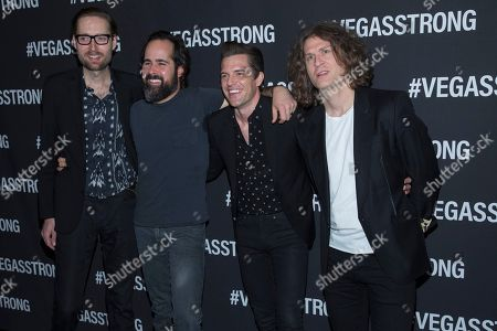 Mark Stoermer, Ronnie Vannucci, Brandon Flowers, Dave Keuning. Mark Stoermer, left, Ronnie Vannucci, Brandon Flowers and Dave Keuning of The Killers arrive at the Vegas Strong Benefit concert at T-Mobile Arena, in Las Vegas