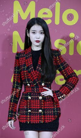 South Korean singer Lee Ji-Eun aka IU poses as she arrives for the Melon Music Awards 2017 at the Gocheok Sky Dome in Seoul, South Korea, 02 December 2017. The Melon Music Awards are a major music event that is held annually in South Korea and is organized by LOEN Entertainment through its online music store and hosted by Roen Entertainment, the company's online music website.