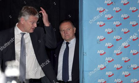 The party's chairman Joerg Meuthen, left, and board member Georg Pazderski, right, talk prior to a party convention of the Alternative for Germany, AfD, party in Hannover, Germany