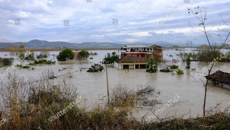 A view of a flooded area at Ferras village at Vlora district, 120 kilometers (75 miles) southwest of the capital Tirana, after non-stop rain caused Vjosa riverbanks to burst in the south of the country, . At least one person has died in the last three days of heavy rainfall that has flooded many parts of Albania, temporarily paralyzing its ports and suspending flights from its only international airport