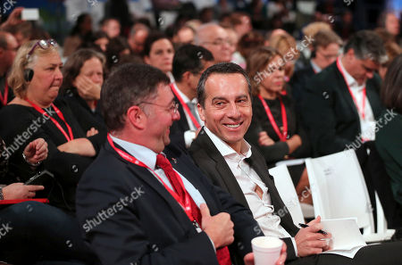 Austria Chancellor Christian Kern, right, smiles while attending the Party of European Socialists Council in Lisbon