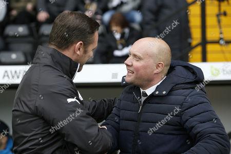 Notts County manager Kevin Nolan greets Oxford City Head Coach Mark Jones