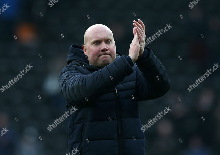 Oxford City Head Coach Mark Jones applauds the fans