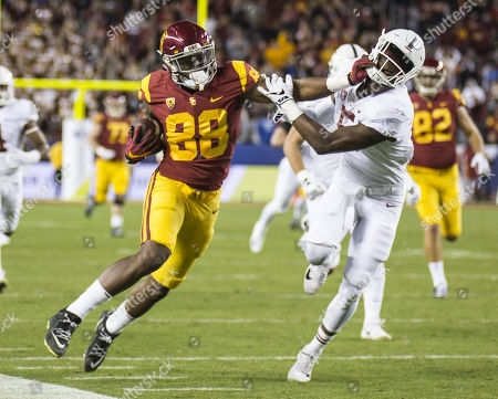 Santa Clara U.S.A CA USC tight end Daniel Imatorbhebhe (88) catch a deep pass from QB Sam Darnold run up the sideline for extra yards during the NCAA Pac 12 Football Championship game between Stanford Cardinal and USC Tro-28 win at Levi Stadium Santa Clara Calif. Thurman James / CSM