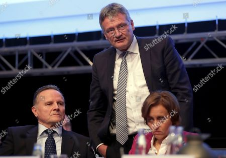The party's co-chairman Joerg Meuthen, center, and board member Georg Pazderski, left, talk during a party convention of the Alternative for Germany, AfD, party in Hannover, Germany