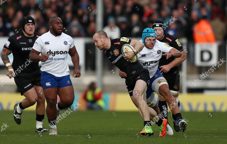 James Short of Exeter Chiefs is tackled by Zach Mercer of Bath Rugby