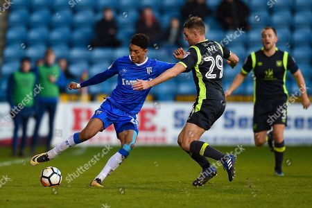 Gillingham FC midfielder Sean Clare (28) and Carlisle United defender Clint Hill (29) during the The FA Cup match between Gillingham and Carlisle United at the MEMS Priestfield Stadium, Gillingham
