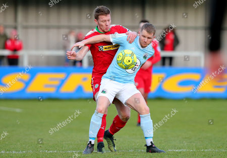 Warrenpoint Town vs Cliftonville. Warrenpoint's Marty Murray and Cliftonville's Stephen Garrett