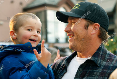 Bode Miller holds his son Nate after a news conference in Beaver Creek, Colo. Miller's ambition now is to be just as entertaining as a ski racing analyst as he was when he competed. He will work for NBC at the Pyeongchang Olympics