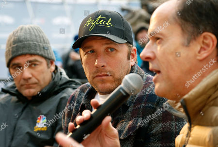 Bode Miller, center, listens during a news conference in Beaver Creek, Colo. Miller's ambition now is to be just as entertaining as a ski racing analyst as he was when he competed. He will work for NBC at the Pyeongchang Olympics