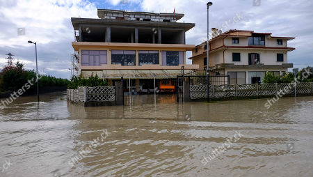 A view of two flooded villas at Ferras village near Ura e Mifolit (Mifoli Bridge), Vlora district, 120 kilometers (75 miles) southwest of the capital Tirana, after non-stop rain caused Vjosa riverbanks to burst in the south of the country, . At least one person has died in the last three days of heavy rainfall that has flooded many parts of Albania, temporarily paralyzing its ports and suspending flights from its only international airport