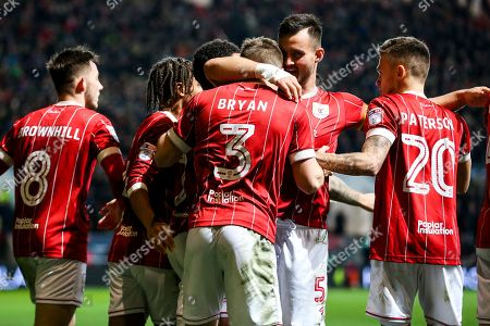 Joe Bryan of Bristol City celebrates with Bailey Wright after scoring a goal to make it 1-0