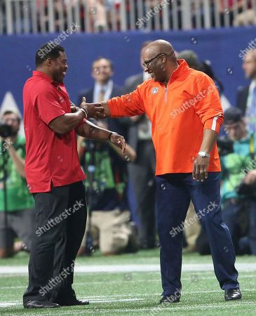 Stock Image of Former Auburn tailback Bo Jackson, right, and ex-Georgia star Herschel Walker speak during the first half of the Southeastern Conference championship NCAA college football game between Auburn and Georgia, in Atlanta. They were recognized on the field during a second-quarter time out. Jackson won the Heisman Trophy in 1985 and Walker captured it three years earlier