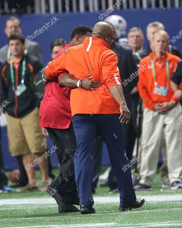 Stock Photo of Former Auburn tailback Bo Jackson, right, and ex-Georgia star Herschel Walker walks off the field during the first half of the Southeastern Conference championship NCAA college football game between Auburn and Georgia, in Atlanta. They were recognized on the field during a second-quarter time out. Jackson won the Heisman Trophy in 1985 and Walker captured it three years earlier