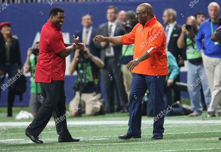 Stock Picture of Former Auburn tailback Bo Jackson, right, and ex-Georgia star Herschel Walker speak during the first half of the Southeastern Conference championship NCAA college football game between Auburn and Georgia, in Atlanta. They were recognized on the field during a second-quarter time out. Jackson won the Heisman Trophy in 1985 and Walker captured it three years earlier