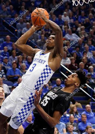 Hamidou Diallo, Robert Baker. Kentucky's Hamidou Diallo (3) shoots as Harvard's Robert Baker (35) defends during the first half of an NCAA college basketball game, in Lexington, Ky