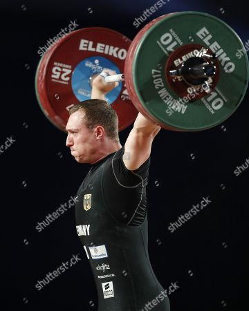 Nico Mueller of Germany completes a lift in the Snatch during the men's 77 kg weight class at the Weightlifting World Championships at the Anaheim Convention Center in Anaheim, California, USA, 02 December 2017.
