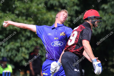 Stock Photo of Jack Hunter (R), bowler of Otago Volts runs past Michael Pollard of Canterbury to deliver a ball during the Ford One Day trophy cricket match between Canterbury and Otago Volts at MainPower Oval, Rangiora, Canterbury, New Zealand, Sunday, Dec. 3, 2017. (Sanka Gayashan/REX/Shutterstock)