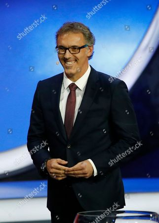 Former French soccer international Laurent Blanc smiles as he walks on stage to assist with the 2018 soccer World Cup draw in the Kremlin in Moscow