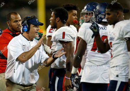 South Alabama coach Joey Jones, left, cheers to his players during a timeout in the second half of an NCAA college football game against New Mexico State in Las Cruces, N.M
