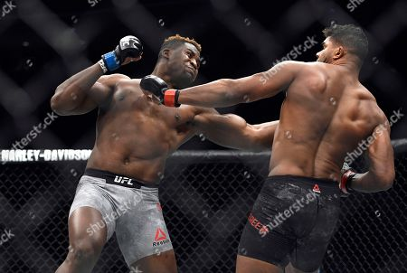 Francis Ngannou, Alistair Overeem. Francis Ngannou, left, hits Alistair Overeem in the first round during a UFC 218 heavyweight mixed martial arts bout, in Detroit. Ngannou defeated Overeem by first-round knockout