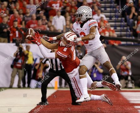 Wisconsin's Danny Davis III (6) tries to make a catch while being defended by Ohio State's Damon Arnette during the second half of the Big Ten championship NCAA college football game, in Indianapolis. The pass was incomplete
