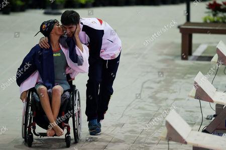 Spain's Teresa Perales kisses Francisco Ocete Hernandez as she leaves the pool after competing in the women's 100M freestyle S5 final, during the World Para Swimming Championships in Mexico City, . The World Para Swimming and Para Powerlifting championships are taking place in Mexico's capital from Dec. 2 to Dec. 8