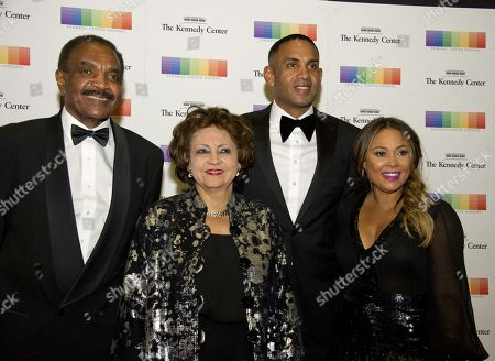 (L-R) Calvin Hill, wife Janet, Grant Hill and wife Tamia, arrive for the formal Artist's Dinner honoring the recipients of the 40th Annual Kennedy Center Honors hosted by United States Secretary of State Rex Tillerson at the US Department of State in Washington, DC, USA, 02 December 2017. The 2017 honorees are: US dancer and choreographer Carmen de Lavallade, Cuban-US singer-songwriter and actress Gloria Estefan, US hip hop artist and entertainment icon LL COOL J, US television writer and producer Norman Lear and US musician and record producer Lionel Richie.