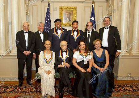 Stock Picture of (L-R, back) David M. Rubenstein, Chairman of John F. Kennedy Center for the Performing Arts, US Secretary of State Rex Tillerson, LL Cool J, Lionel Richie, Glenn Weiss, and Ricky Kirshner, Executive Producers with White Cherry, (L-R, front) Carmen de Lavallade, Norman Lear, Gloria Estefan and Deborah F. Rutter, President of the John F. Kennedy Center for the Performing Arts pose for a photo following a dinner hosted by United States Secretary of State Rex Tillerson in their honor at the US Department of State in Washington, DC, USA, 02 December 2017. The 2017 honorees are: US dancer and choreographer Carmen de Lavallade, Cuban-US singer-songwriter and actress Gloria Estefan, US hip hop artist and entertainment icon LL COOL J, US television writer and producer Norman Lear and US musician and record producer Lionel Richie.