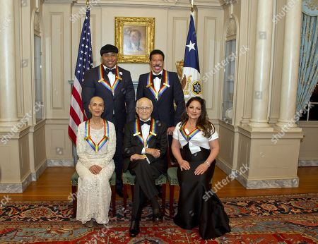 Stock Photo of (L-R, back) LL Cool J and Lionel Richie, (L-R, front) Carmen de Lavallade, Norman Lear and Gloria Estefan pose for a group photo following a dinner hosted by United States Secretary of State Rex Tillerson in their honor at the US Department of State in Washington, DC, USA, 02 December 2017. The 2017 honorees are: US dancer and choreographer Carmen de Lavallade, Cuban-US singer-songwriter and actress Gloria Estefan, US hip hop artist and entertainment icon LL COOL J, US television writer and producer Norman Lear and US musician and record producer Lionel Richie.