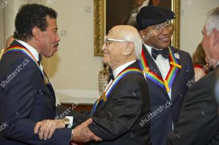 US singer-songwriter Lionel Richie (L) shares an embrace with US television writer and producer Norman Lear (C-L) while US rapper LL Cool J (C-R) converses with United States Secretary of State Rex Tillerson (R) prior to the five recipients of the 40th Annual Kennedy Center Honors posing for a group photo following a dinner hosted by Secretary Tillerson in their honor at the US Department of State in Washington, DC, USA, 02 December 2017. The 2017 honorees are: US dancer and choreographer Carmen de Lavallade, Cuban-US singer-songwriter and actress Gloria Estefan, US hip hop artist and entertainment icon LL COOL J, US television writer and producer Norman Lear and US musician and record producer Lionel Richie.