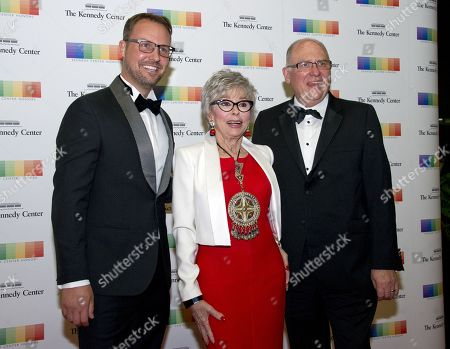 From left, Producer Brent Miller, 2015 Kennedy Center Honoree Rita Moreno, and manager John Ferguson arrive for the formal Artist's Dinner honoring the recipients of the 40th Annual Kennedy Center Honors hosted by United States Secretary of State Rex Tillerson at the US Department of State in Washington, D.C., 02 December 2017 (issued 03 December 2017). The 2017 honorees are: US dancer and choreographer Carmen de Lavallade, Cuban-US singer-songwriter and actress Gloria Estefan, US hip hop artist and entertainment icon LL COOL J, US television writer and producer Norman Lear and US musician and record producer Lionel Richie.