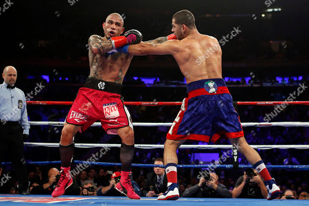 Miguel Cotto, Sadam Ali. Miguel Cotto, left, of Puerto Rico, and Sadam Ali trade blows during the second round of a WBO junior middleweight title boxing match, in New York