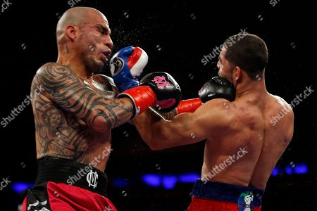 Miguel Cotto, Sadam Ali. Miguel Cotto, left, of Puerto Rico, punches Sadam Ali, during the third round of a WBO junior middleweight title boxing match, in New York