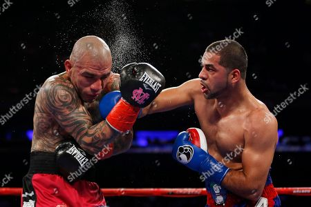 Miguel Cotto, Sadam Ali. Sadam Ali, right, punches Miguel Cotto during the fifth round of a WBO junior middleweight title boxing match, in New York