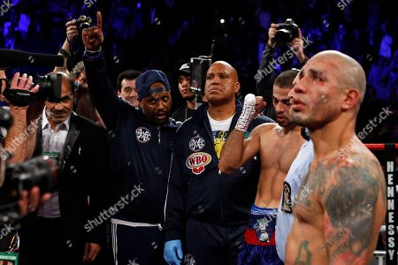 Miguel Cotto, Sadam Ali. Sadam Ali clenches his fist after defeating Miguel Cotto, right, in a WBO junior middleweight title boxing match, early, in New York