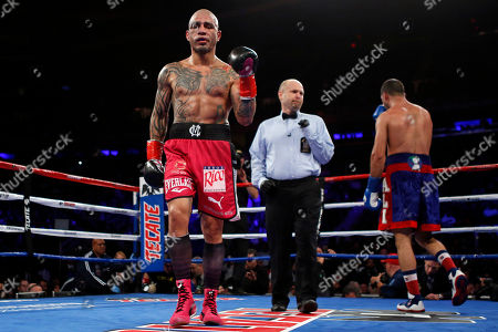Miguel Cotto, Sadam Ali. Miguel Cotto walks back to his corner after the sixth round against Sadam Ali during a WBO junior middleweight title boxing match, in New York