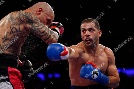 Stock Image of Miguel Cotto, Sadam Ali. Sadam Ali, right, punches Miguel Cotto during the fifth round of a WBO junior middleweight title boxing match, in New York