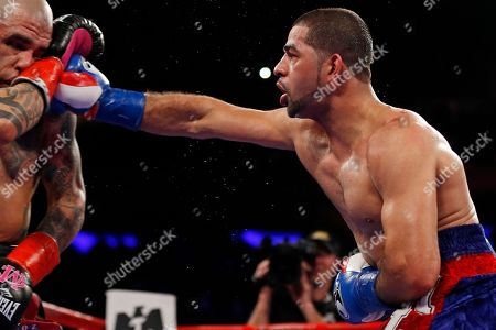 Miguel Cotto, Sadam Ali. Sadam Ali, right, punches Miguel Cotto during the 10th round of a WBO junior middleweight title boxing match, in New York