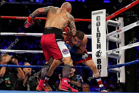 Stock Picture of Miguel Cotto, Sadam Ali. Miguel Cotto, left, of Puerto Rico, punches Sadam Ali during the fifth round of a WBO junior middleweight title boxing match, in New York