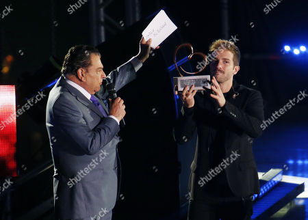 Presenter Mario Kreutzberger (L) greets Spanish singer Pablo Alboran (R) during his presentation at the closing of the Chilean Teleton at the National Stadium in Santiago, Chile, 02 December 2017. The Teleton of Chile started on 01 December with the aim of exceeding the goal of 32 billion pesos (around 50 million US dollars) last year, resources that will be used to maintain the attention of 14 institutes for children and young people with disabilities throughout the country.