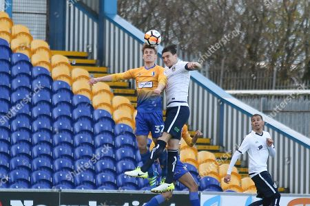 Stock Picture of Zayn Hakeem of Mansfield (37) and Ashley Palmer of Guiseley AFC (5) up for a header during the The FA Cup match between Mansfield Town and Guiseley  at the One Call Stadium, Mansfield