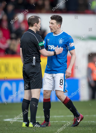 Ryan Jack of Rangers appeals to referee William Collum after being shown a red card for a challenge on Stevie May of Aberdeen