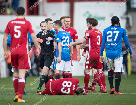 referee William Collum shows a straight red card to Ryan Jack of Rangers for a challenge on Stevie May of Aberdeen
